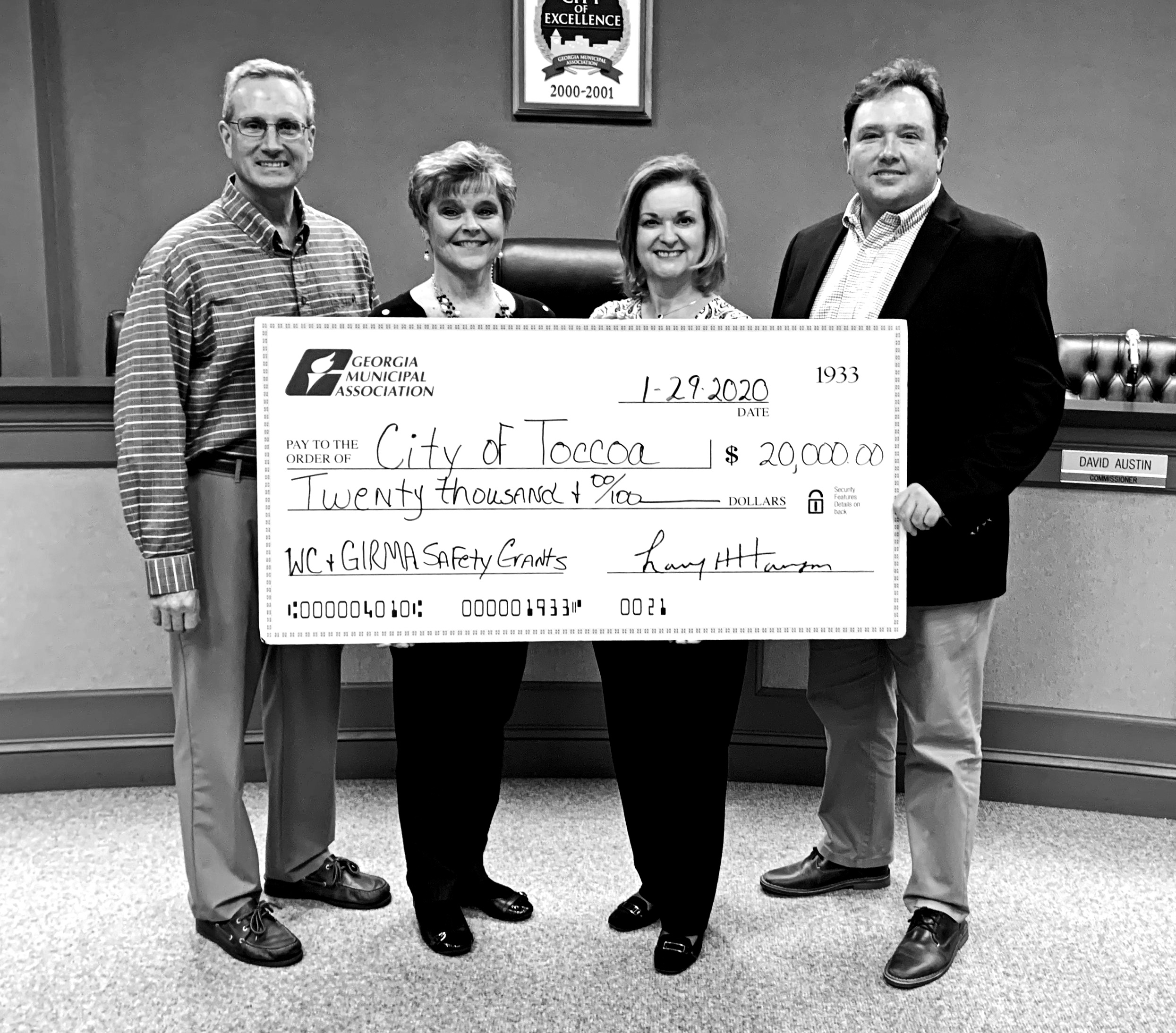 Exhibiting one of the giant GMA checks are (from left) city manager Billy Morse, city human resources director  Jan Crawford, GMA representative Brenda Eckman and Toccoa Mayor Terry Carter.
