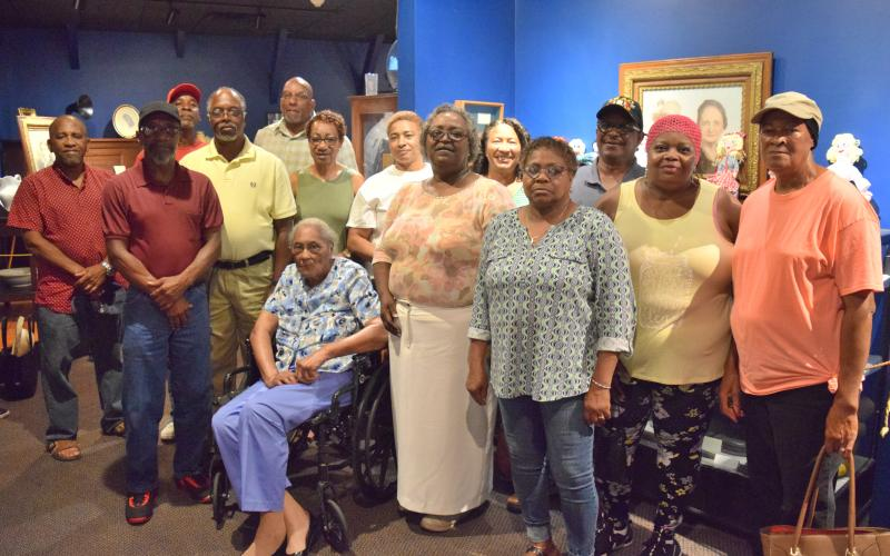 Pictured are former students and a teacher of Oak Hill Elementary School. They are Hayward Cochran Jr, Thomas Richie, Charlene Hayes Echols, Frances Smith, Shirley Combs, Peggy Combs, Jerry Haymond, Walter Richie, Calvin Combs, Doris Prather, Rachel Burton, Shirley Lippitt, Roy Richie and Jeraldine Hayes.