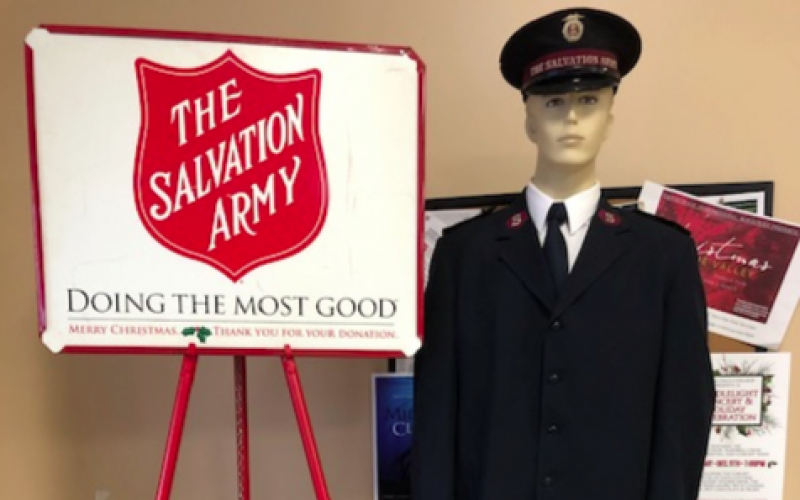 Iconic Salvation Army red kettles will be accompanied by human bell-ringers. This season apps to make a donation at the kettle also are offered.