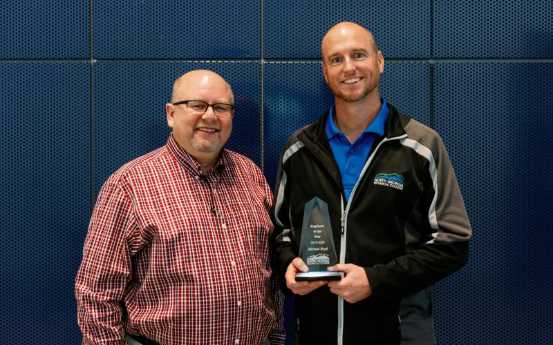 NGTC president Dr. Mark Ivester (left) and employee of the year Michael Boyd (right).