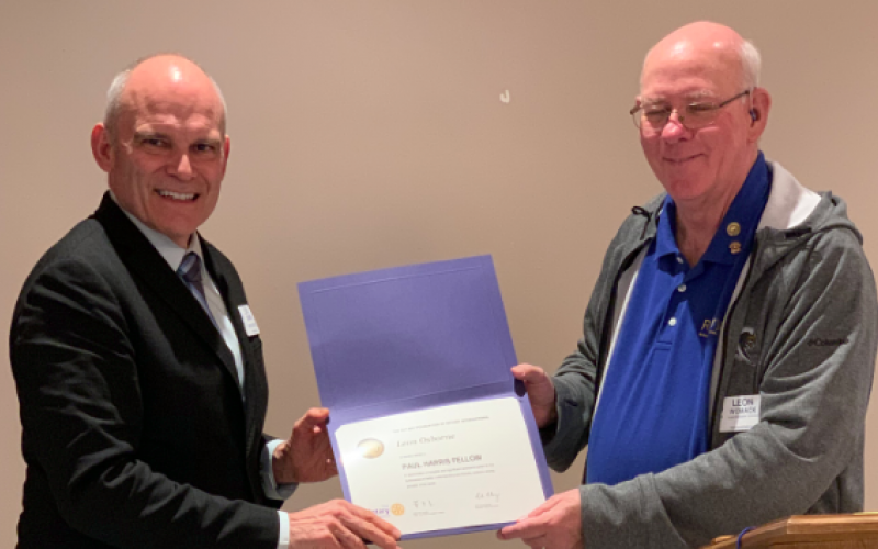 Leon Osborne (left) receives the Paul Harris Fellow designation from Toccoa Rotary Club president Leon Womack (right).