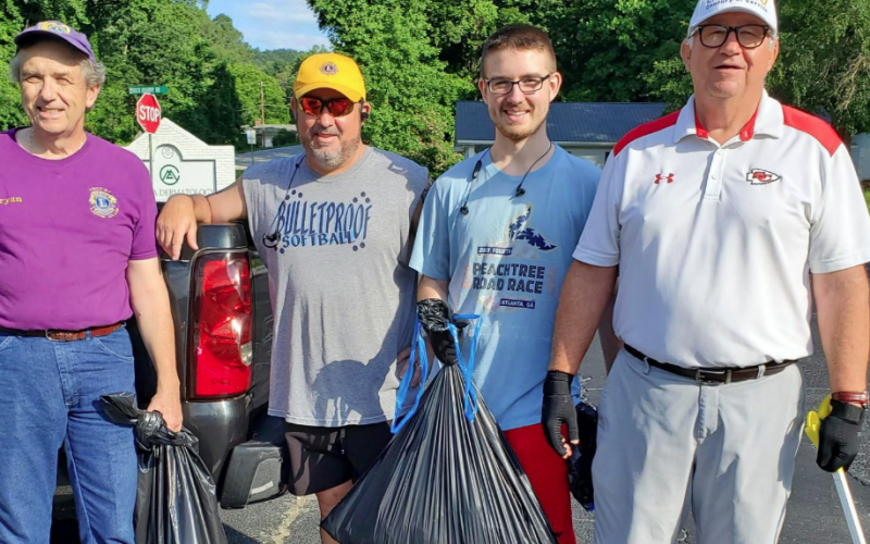 Pictured are Lions Club members resting after cleaning up litter along Falls Road last Saturday.  They are (from left) Bryan Gordon, Tim McLaughlin, Jack McLaughlin and Jack McLaughlin. Lions not pictured are Brenda Gordon, Jack Barnard and Dan Huff.