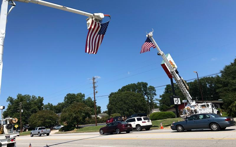 This was the scene Tuesday afternoon on Big A Road – large American flags draped across the roadway in honor of the late Stan Elrod.