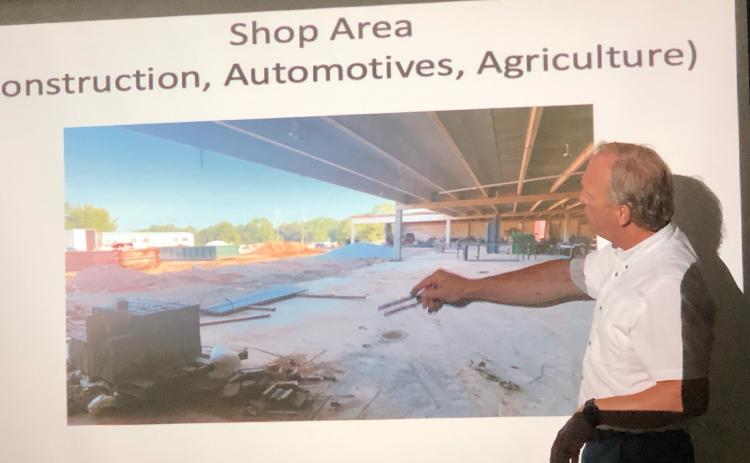 School superintendent Bryan Dorsey shows school board members the ongoing work that's underway at the high school, an area into which automotive, construction and agriculture classes will move.