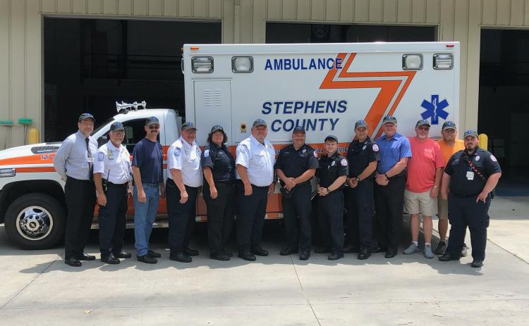 Past and present members of the Stephens County EMS recently gathered to kick off the celebration of the 50th anniversary of the ambulance service. Pictured are (from left) hospital CEO Mike Hester, EMS director Aaron Wilkinson, Andrew Burkhart, Chris Stephens, Donna Kieffer, Bobby Westmoreland, Matt Moore, Jake Murray, Blake Simpson, Stanley Ansley, James Norris, Tony Thomas and Joshua Smith.