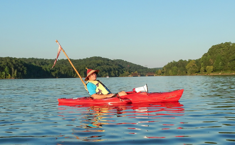 Local historian Kelly Vickers leans back and soaks in the beauty that is the Tugaloo River Sunset Paddle held the Saturday before Labor Day.