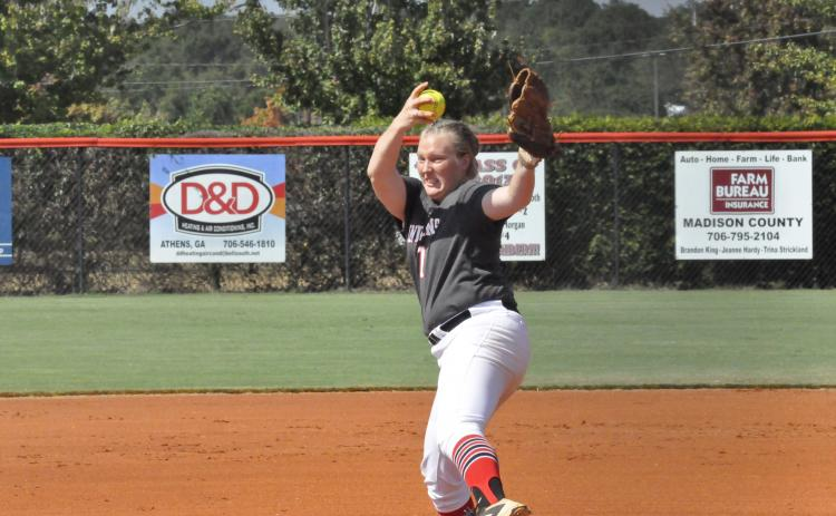 Aly Singletary fires a pitch in the region tournament