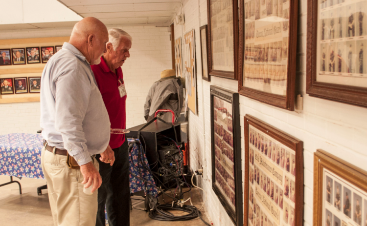 'Old Guard' members Nicky Willis and Benny Cheek check the National Guard photos from the 1980s.