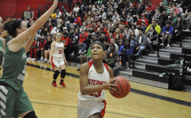 Kiki Howard goes up for a layup against a Franklin County player