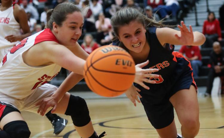 Lindsay Moore fights for a loose ball with a Habersham player. Courtesy of David Byargeon
