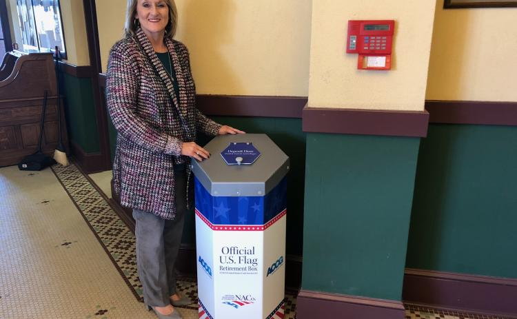 County clerk Beth Rider with the new flag disposal box.