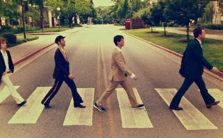 Members of Abbey Road Live! restage the iconic Beatles album cover photograph.
