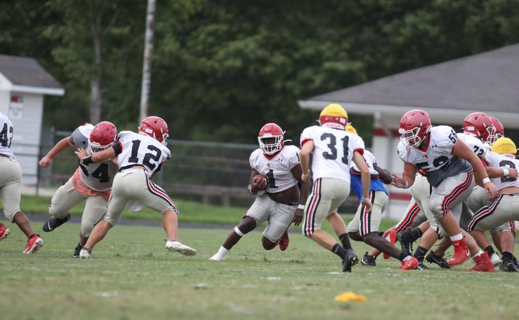 Indian running back Zach Feaster (1) looks for running room during a recent Stephens scrimmage.