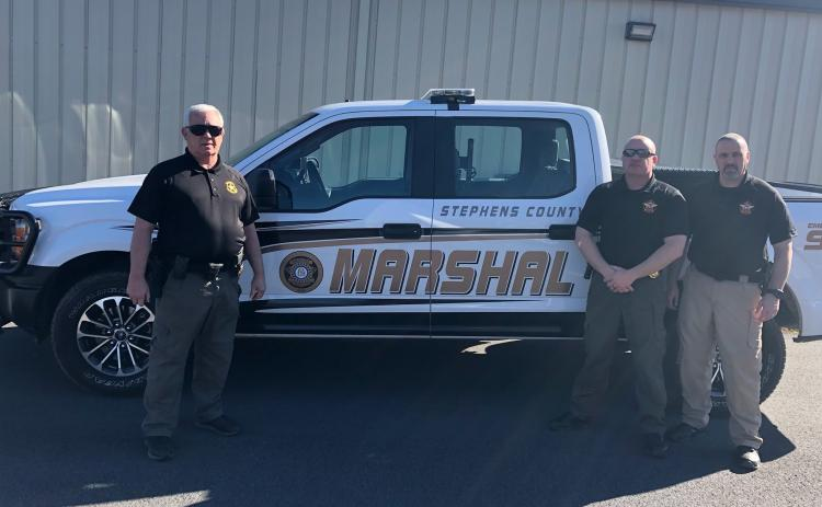 Stephens County has expanded its county marshal services from two to three marshals. They are (from left) chief Tony Addison, Joe Smith  and Rik Wise.