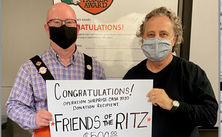 Wesley Copelan (left) of Home Depot and Friends of the Ritz president Gary Cortellino (right) celebrate the $500 Home Depot Operation Surprise grant.